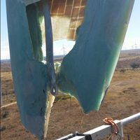 a severely damaged wind turbine rotor blade in need of repair
